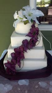 Square And Round Wedding Cake With White Purple Orchids On Central