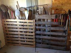 Use Pallets To Hold Shovels And Yard Equipment