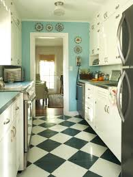 black and white kitchen tile floor with light blue patern