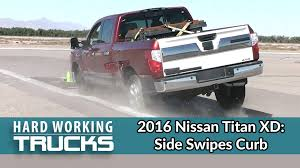2016 Nissan Titan XD Slams Sideways Into A Curb During An Impact ... 2016 Nissan Titan Xd Endures Projectile Impact Test To Rightfront Hshot Hauling How Be Your Own Boss Medium Duty Work Truck Info Cc Outtakes Two Ford Cseries Trucks Still Hard At Chevy Shows Off Silverado Special Ops Concept Volvo L220g Wheelloader Working Loading And Scania The 2013 Super Take A Look The Powerful March Feature X Trucking Ram 2500 For Sale In Hays Ks Marmie Chrysler Bangshiftcom Sema 2014 2007 Chevrolet Roadside Assistance Review Gallery Uberlike Truck Business Underway New York