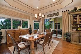 Exquisite Mediterranean Diningroom Dining Room With Wood Floor Paired Brown Chairs Recessed Lighting Woven Collection Of Window