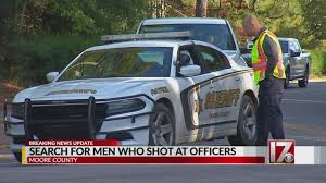 100 Two Men And A Truck Raleigh NC Gunman Opens Fire On Police Through Lexus Sunroof Pair On The