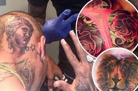As Chris Brown Gets His HEAD Tattooed The Worst Celebrity Inkings From Cheryl To Ed Sheeran