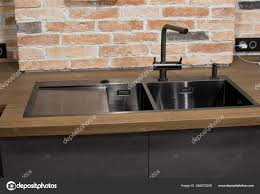 Kitchen Faucet Water Modern Kitchen With Black Sink Kitchen Faucet For Water And Fronts Against The Background Of A Brick Wal Brown And Black Wooden Countertops Luxury
