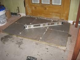 installing a tile landing plus raising a door sill building moxie