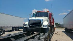 Professional Transport Services For A Dump Truck From Heavy Haulers