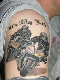 Fantastic Racing Bike Tattoo On Mens Back Shoulder