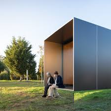MIMA Light Is A Small Prefabricated House Raised Up From The Landscape On Near Invisible Base
