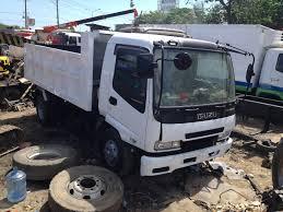 100 Surplus Trucks UFT HEAVY EQUIPMENT AND TRUCKS 2010 ISUZU FORWARD DUMP