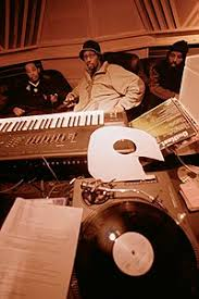 Hip Hop Producer And Rapper RZA In A Music Studio With Two Collaborators Pictured The Foreground Is Synthesizer Keyboard Number Of Vinyl Records