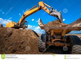 100 Digger Truck Videos Yellow Excavator Loading Soil Into A Dumper Stock Image