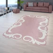 kurzflor teppich rosa pink wohnzimmer weiße bordüre