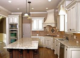 brown wall color with classic white kitchen cabinet using