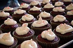 Chocolate Cupcakes With Icing And Red Sprinkles