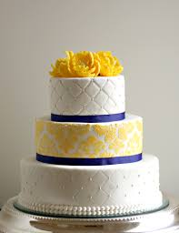 The wedding cake incorporated a damask pattern like the invitation in addition to a quilting pattern The cake flavors included white cake with raspberry