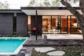 Black Lava Stone From Mexico Surrounds The White Terrazzo Back Porch Which Overlooks A Small