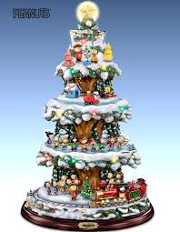 A PEANUTS Christmas Tabletop Tree With Lights Music And Motion Rotating Train Skaters