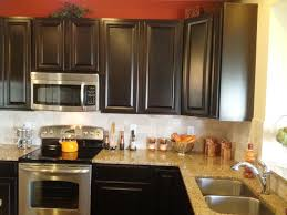 Kitchen Backsplash Ideas With Dark Wood Cabinets by Espresso Kitchen Cabinets In 12 Sleek And Cool Designs Rilane