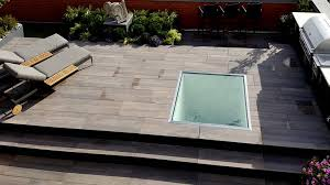 Thinset For Porcelain Tile On Concrete by Porcelain Pavers For Rooftop Decks Patios And Terraces
