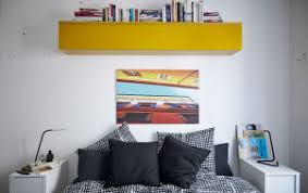 Monochrome Textiles Plus Colourful And Practical Storage Create A Cohesive Bedroom