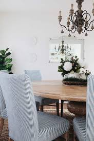 French Country Dining Room In White With Natural Wood Blue And Striped Chairs