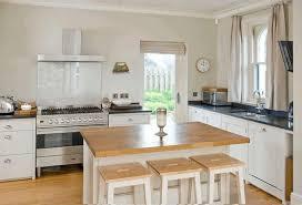 tiny kitchen island white brick walls light wood dining set oak