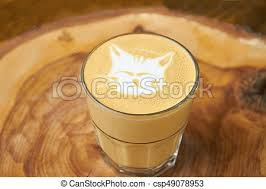Latte Glass With Cat Art Coffee Foam And Blurred Background Cute Tasty