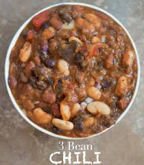 Overhead View Of A White Bowl Filled With Vegetarian Chili Cooked Cannellini Beans Black