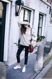 Cropped Jeans Are The Perfect Choice For A Practical Summer Style Beatrice Gutu Pairs Distressed Black With Simple Beige Sweater And