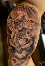 This Specific Dove Tattoo Shows What Appears To Be A White Flying Towards Rose Flower Above The Are Some Clouds Which Make It Seem Like