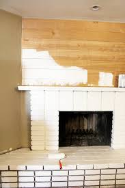 diy planked mantle and white brick fireplace classy clutter