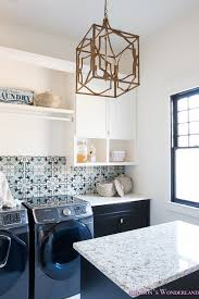 laundry room organization ideas white black cabinets cement tile