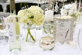 Florals Centerpieces From An Elegant White Outdoor Dinner Party Via Karas Ideas