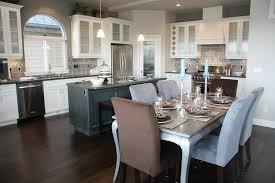 White Kitchen With Dark Hardwood Flooring