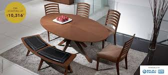 SURELY WITHIN YOUR REACH A 6 Seater Walnut Oval Dining Table With A