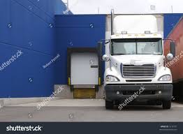 Semi Loading Dock Stock Photo 1216131 - Shutterstock Home Nova Technology Loading Dock Equipment Installation Lifetime Warranty Tommy Gate Railgate Series Dockfriendly Mson Tnt Design The Determine Door Sizes Blue Truck At Image Scenario Cpe Rources Dock With Truck Bays In Back Of Store Stock Photo Ultimate Semi Back Up Into Safely Reverse Drive On Emsworth Ptoons And Floating Platforms Inflatable Shelter Stertil Products Freight Semi Trucks Cacola Logo Loading Or Unloading At