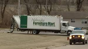 nebraska furniture mart truck damaged after striking truck stock