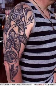 Celtic Tribal Dragon Tattoo On Upper Arm