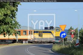 railroad crossing with passing train 4f70d1