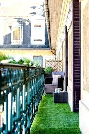 Small Apartment Patio Ideas Balcony An Artificial Grass Rug And Several Window Box Planters