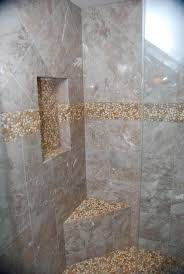shower with niche corner seat pebble border and accent
