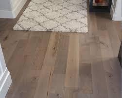 novella dickinson maple floor shown in an entryway installation