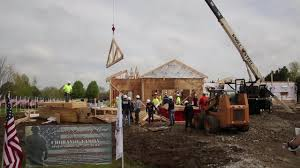 Sycamore Pumpkin Fest Flag by Volunteers Start Building House For Naperville Veteran