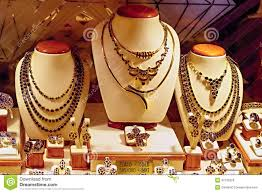 Store Window Display Of Gold And Garnet Jewelry