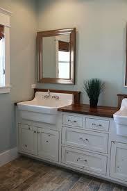 fancy farmhouse sink in bathroom with bathroom vanity with