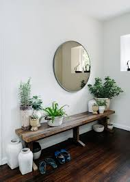 View In Gallery Stunning Entryway Setup With Rustic Bench Round Mirror And Lots Of Plants