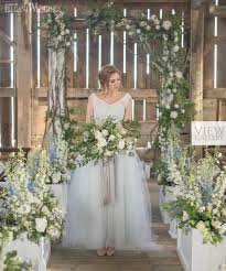 Wedding Ceremony With Bride Holding A Rustic Blue Bouquet