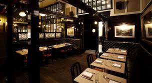 dining room interior design of the breslin restaurant new york