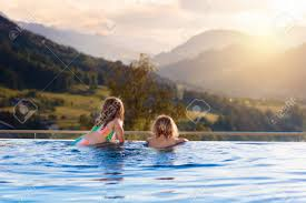 100 Infinity Swimming Kids Play In Outdoor Infinity Swimming Pool Of Luxury Spa Alpine