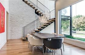 Modern Dining Room With Hardwood Floors And 16 Light Mini Pendant Lamp